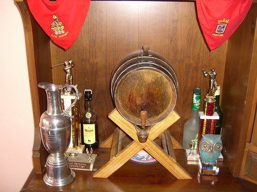 Wine, liquor, and golf trophies.