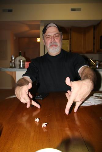 Dennis Rolls the Piggy Dice