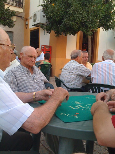 Playing cards with old men