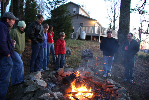 John, Linda, David, Amy, Donna, Leighton, Joshua, and Seth warm themselves by the fire