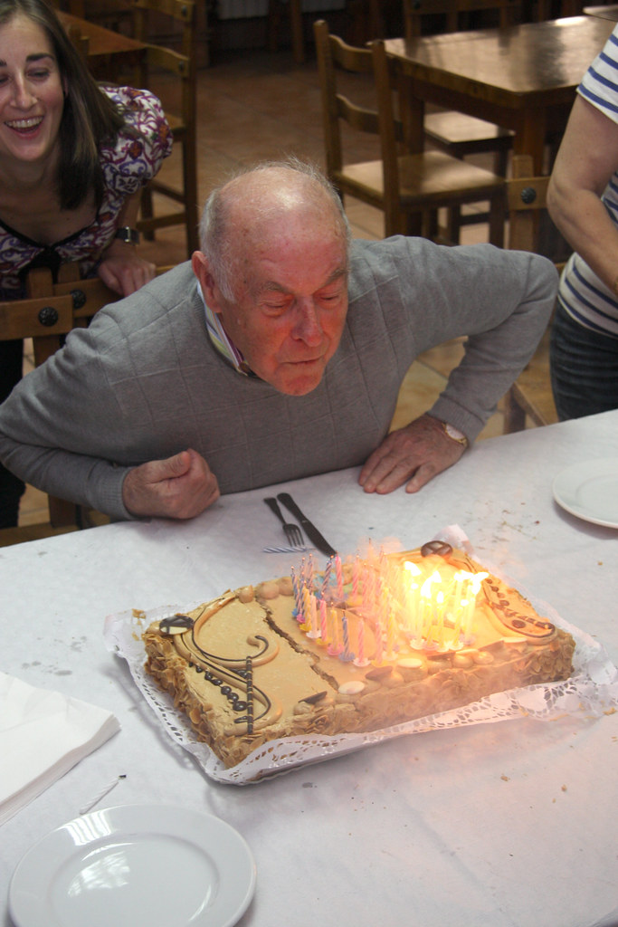 Abuelo extinguishes candles