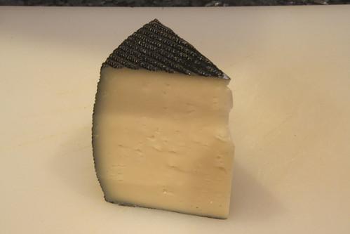 Semi-cured cheese wedge