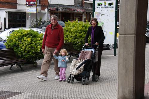 Nora on a walk with Grandma and Grandpa