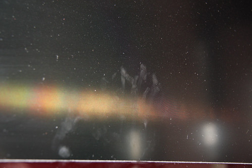 Fingerprints on dusty television screen