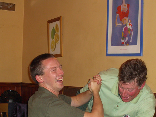 Paul and Eric arm wrestle