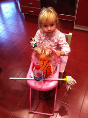 Mop, bottle of water, spool of thread, two Disney figurines and a basketball