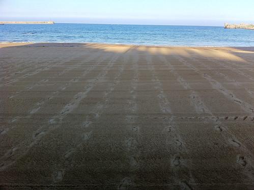 Odd Beach Footprints
