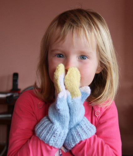 Nora with Mitten Puppets