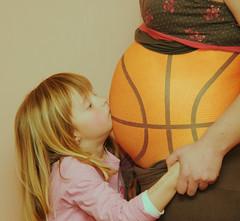 Pregnant Basketball Kiss
