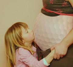 Pregnant Golf Ball Kiss
